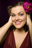 Portrait of beauty brunette woman with flower in her hair. Close up Stock Photos