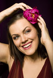 Portrait of beauty brunette woman with flower in her hair Royalty Free Stock Photo