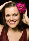 Portrait of beauty brunette woman with flower in her hair. Close up Stock Image