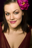 Portrait of beauty brunette woman with flower in her hair. Close up Stock Images