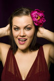 Portrait of beauty brunette woman with flower in her hair. Close up Royalty Free Stock Photography
