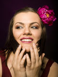 Portrait of beauty brunette woman with flower in her hair Stock Image