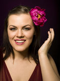 Portrait of beauty brunette woman with flower in her hair. Close up Royalty Free Stock Photo