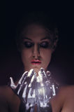 Portrait of beauty cyber woman from the future with clay hairstyle and silver hands Royalty Free Stock Photography