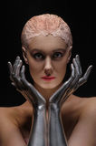 Portrait of beauty cyber woman from the future with clay hairstyle and silver hands Royalty Free Stock Image