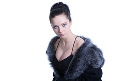Beautiful woman with decollete in luxury black fur Royalty Free Stock Photos