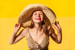 Portrait of beauty fashion model in straw hat Stock Photos