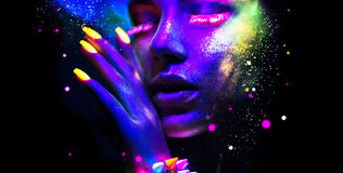 Portrait of beauty fashion woman in neon light. Fashion woman in neon light, portrait of beauty model with fluorescent makeup Stock Photography