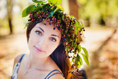 Portrait of beauty girl in autumn park. With yellow foliage Stock Image