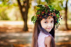 Portrait of beauty girl in autumn park. With yellow foliage Royalty Free Stock Photo