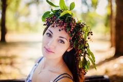 Portrait of beauty girl in autumn park. With yellow foliage Royalty Free Stock Images