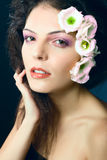 Portrait of beauty girl with flowers hair. Head shot / portrait of female model - beauty girl - with flowers in her hair - made in studio on dark background Royalty Free Stock Image
