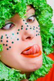 Portrait of a beauty girl with salad in a head Royalty Free Stock Photos