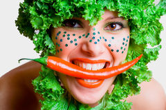 Portrait of a beauty girl with salad in a head Royalty Free Stock Image