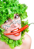 Portrait of a beauty girl with salad in a head Royalty Free Stock Images