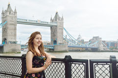 Portrait of a beauty girl with Tower Bridge on background in London Royalty Free Stock Photography