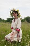 Portrait of beauty girls in camomile chaplet. Girl in flowers wreath and traditional clothes stock image