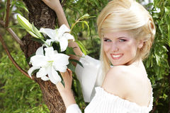 Portrait beauty happy blonde young woman. With white lily, nature Stock Photography