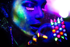 Portrait of beauty model with fluorescent makeup Stock Images