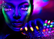 Portrait of beauty model with fluorescent makeup Stock Photos