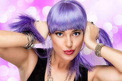 Lovely Joyful Girl. Stylish Purple Hair. Portrait of beauty party girl with purple ponytails Royalty Free Stock Images