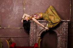 Portrait of beauty sensual young woman in oriental style in luxury room Stock Photo