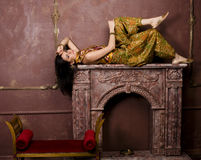 Portrait of beauty sensual young woman in oriental style in luxury room Stock Images