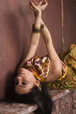 Portrait of beauty sensual young woman in oriental style in luxury room Stock Photography