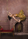 Portrait of beauty sensual young woman in oriental style in luxury room Royalty Free Stock Photo