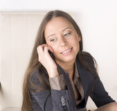 Portrait of beauty sexy business lady talking on phone and smiling Stock Photos