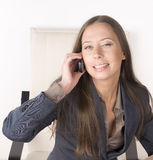 Portrait of beauty sexy business lady talking on phone and smiling Royalty Free Stock Photo