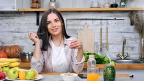 Portrait of beauty smile woman eat appetizing yoghurt using spoon at cosiness cuisine