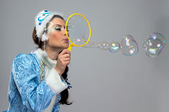 Portrait of beauty snow maiden blowing bubble Stock Photo