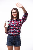 Portrait of  beauty student girl with hello gesture  drink tea or coffee from paper cup Stock Images
