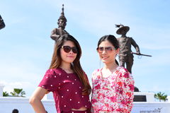 Portrait beauty twin Thai girl. With giant Kings statues and blue sky in action smile, Rajabhakti Park Thailand Royalty Free Stock Image