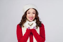 Portrait of beauty winter asian girl in knitted woolen clothing. Hat Stock Image