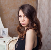 Portrait of beauty woman in classical interior Royalty Free Stock Photography