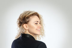 Portrait of beauty woman with curly blonde hair smiling. Horizontal portrait of beauty woman with curly blonde hair smiling on camera in studio Royalty Free Stock Photography