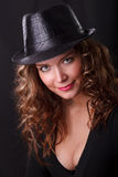 Portrait of beauty woman in dark hat Royalty Free Stock Photos