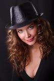 Portrait of beauty woman in dark hat. Glamor Portrait of beauty woman in dark hat royalty free stock photos