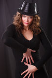 Portrait beauty woman  in the dark hat Stock Images