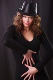 Portrait beauty woman in the dark hat. Artistic portrait of beauty woman in the dark hat stock images