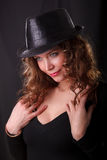 Portrait of beauty woman in dark hat. Glamour portrait of beauty woman in dark hat stock photography