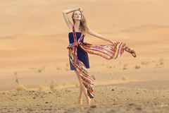 Portrait of a beauty woman in a dress in the hot desert Royalty Free Stock Images
