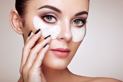 Portrait of Beauty woman with eye patches stock photos