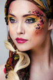 Portrait of beauty woman with face art Stock Photo