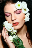 Portrait of beauty woman face with flowers. Portrait of female model - beauty girl - eyes closed, with flowers in her hair Stock Photos