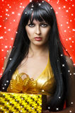 Portrait of beauty woman with gold christmas gift Royalty Free Stock Images