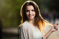 Portrait of beauty woman with perfect smile walking on the street and looking at camera, sunset light stock images
