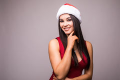 Portrait of beauty woman in red dress and Christmas santa hat Stock Photo
